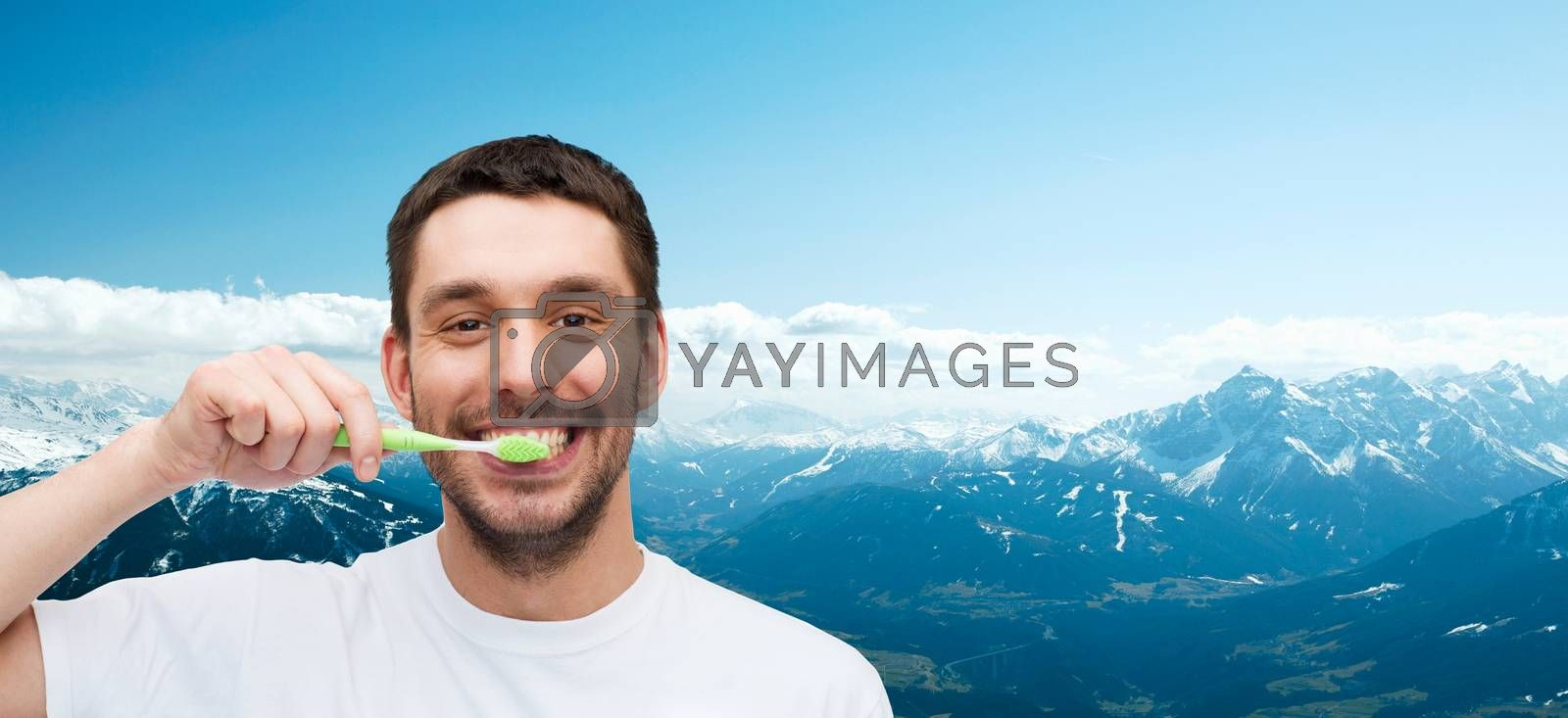 health and beauty concept - smiling young man with toothbrush