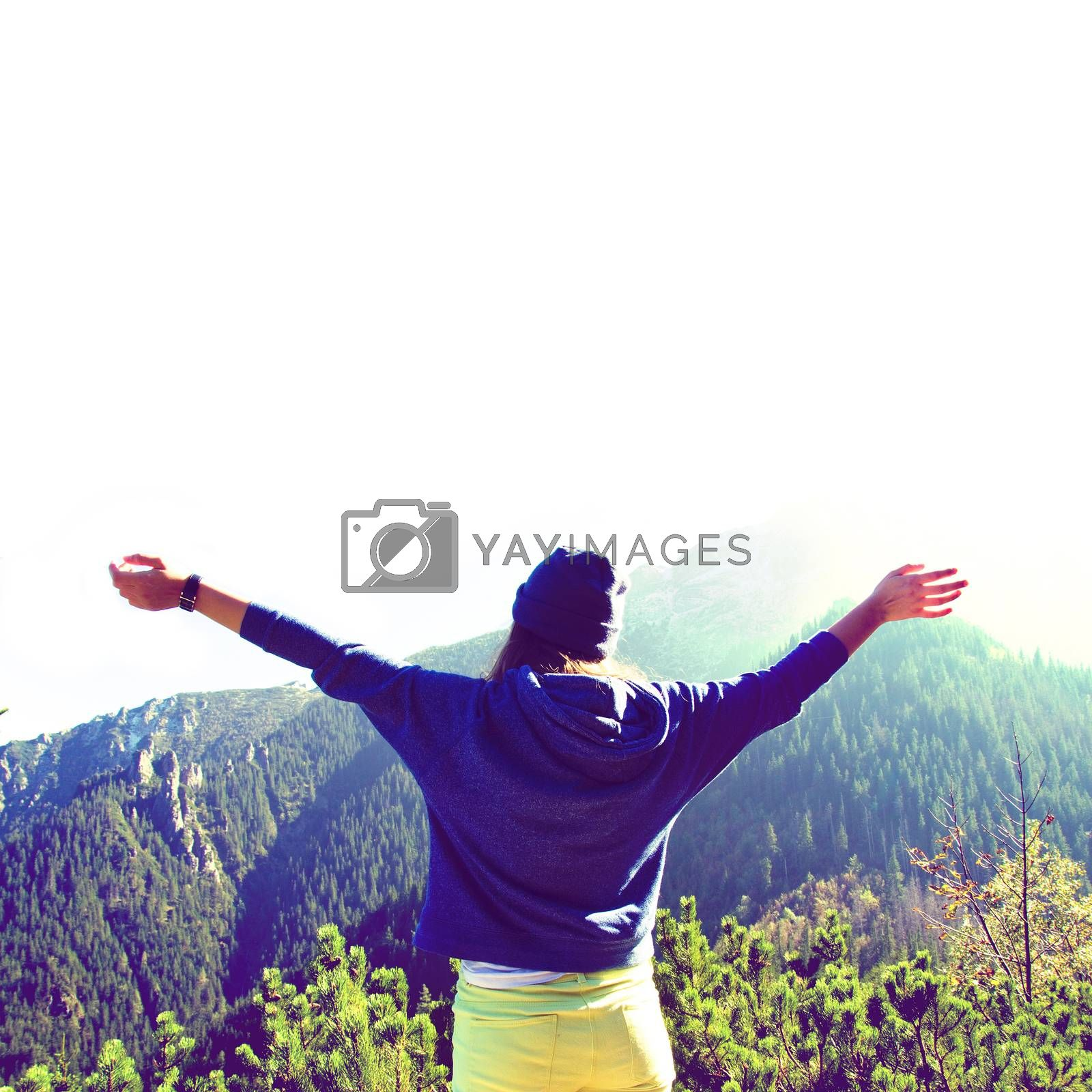 Happy teenage girl feel freedom in mountains scenery. Vintage, retro style.