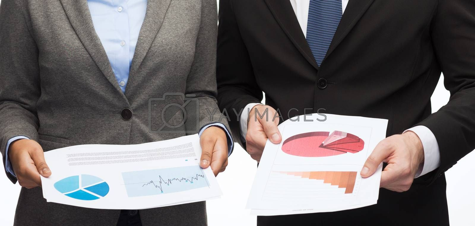 business and economy concept - smiling businesswoman and businessman with graphs and charts