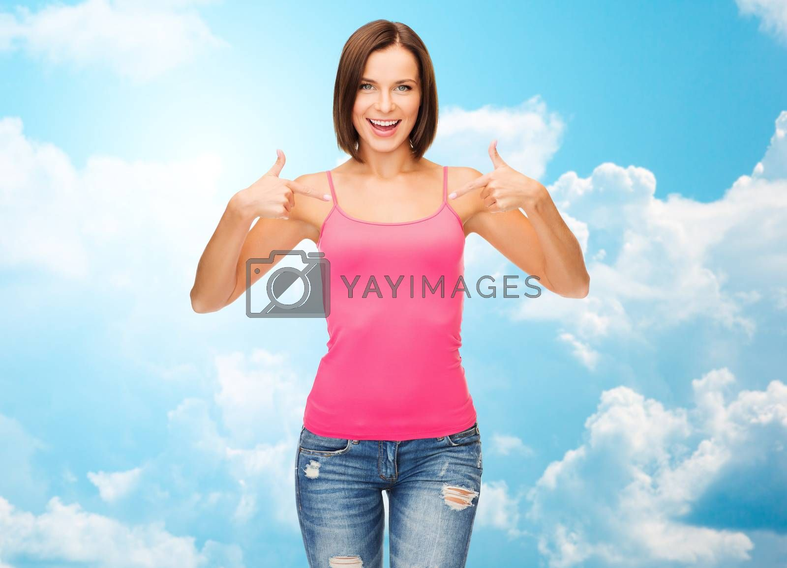 people, advertisement and clothing concept - smiling woman in blank pink tank top pointing fingers to herself over blue sky with white clouds background