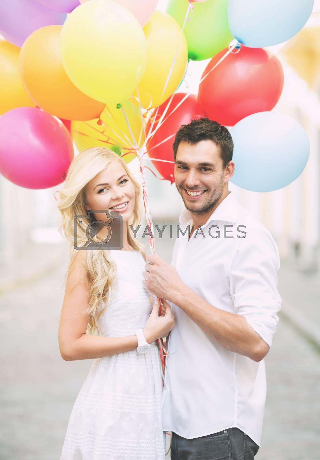 summer holidays, celebration and dating concept - couple with colorful balloons in the city