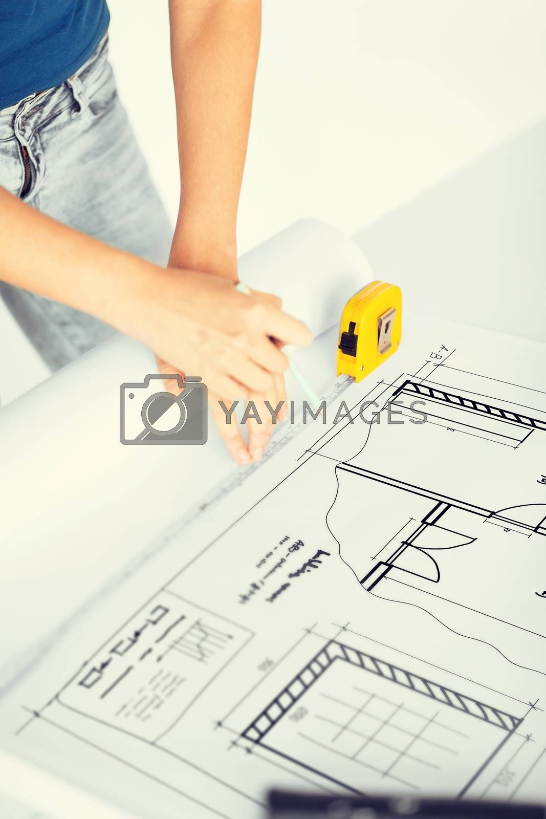 architecture and home renovation concept - architect drawing on blueprint using flexible ruler