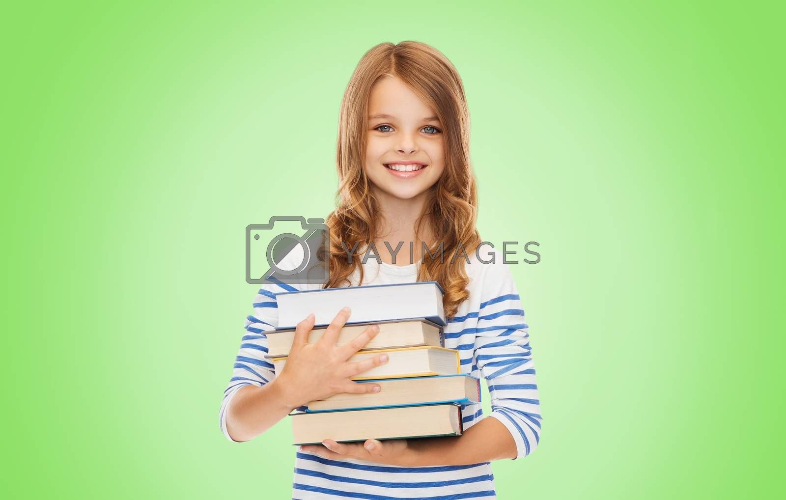 education, people, children and school concept - happy little student girl with many books over green background