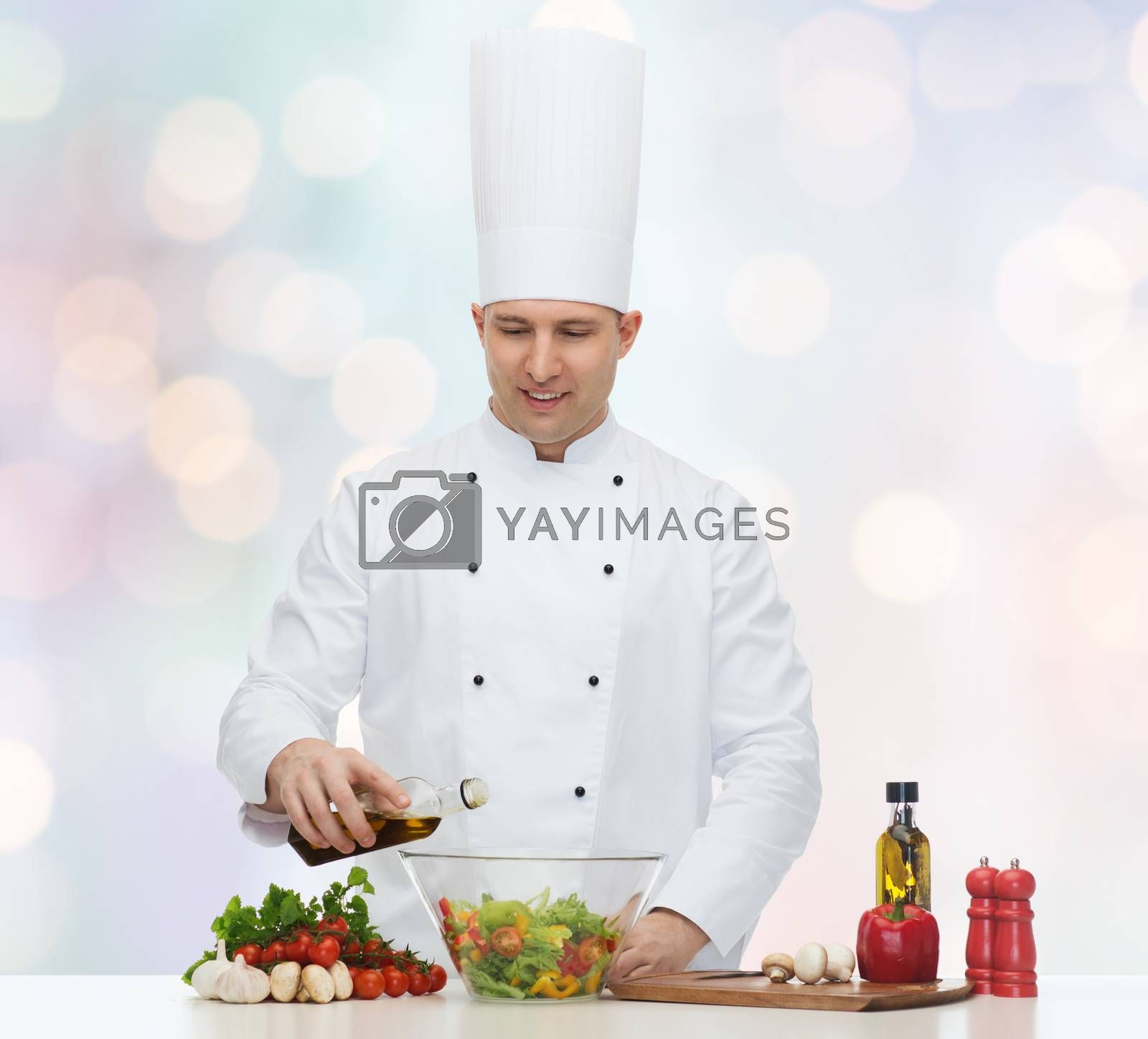 profession, vegetarian, food and people concept - happy male chef cooking salad over blue lights background