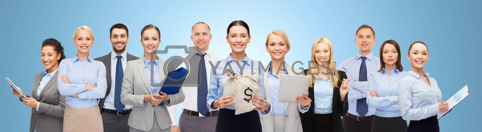 business, people, finances and banking concept - group of happy businesspeople with money bags over blue background
