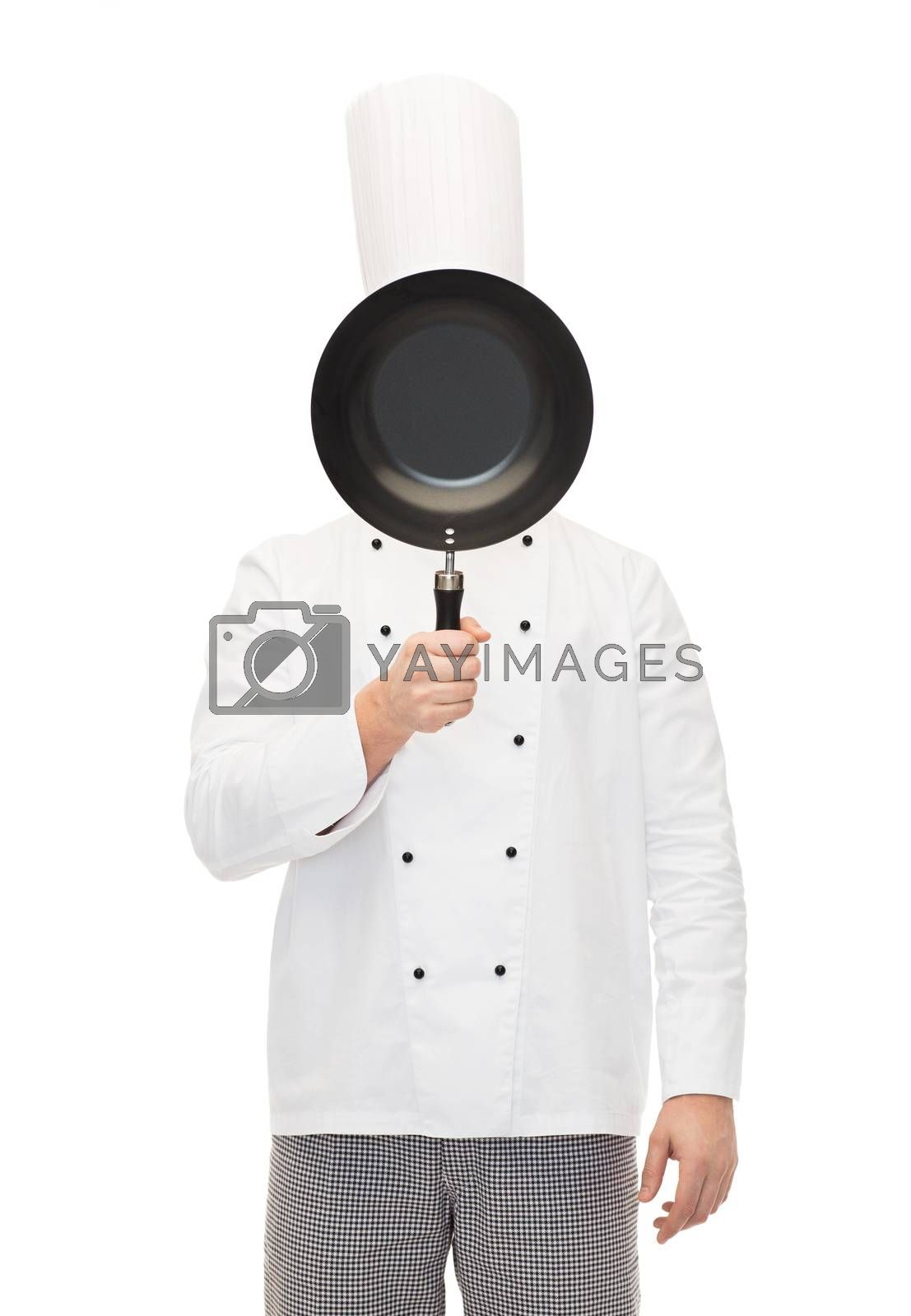 cooking, profession and people concept - male chef cook covering face or hiding behind frying pan
