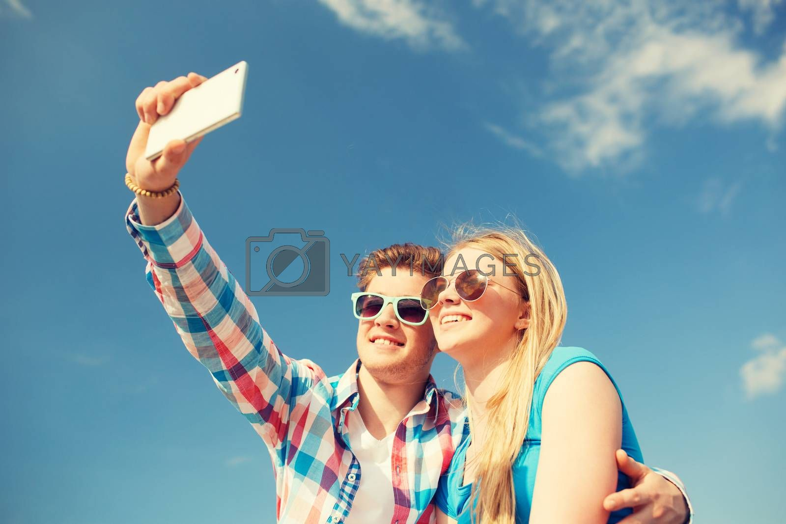Royalty free image of smiling couple having fun outdoors by dolgachov