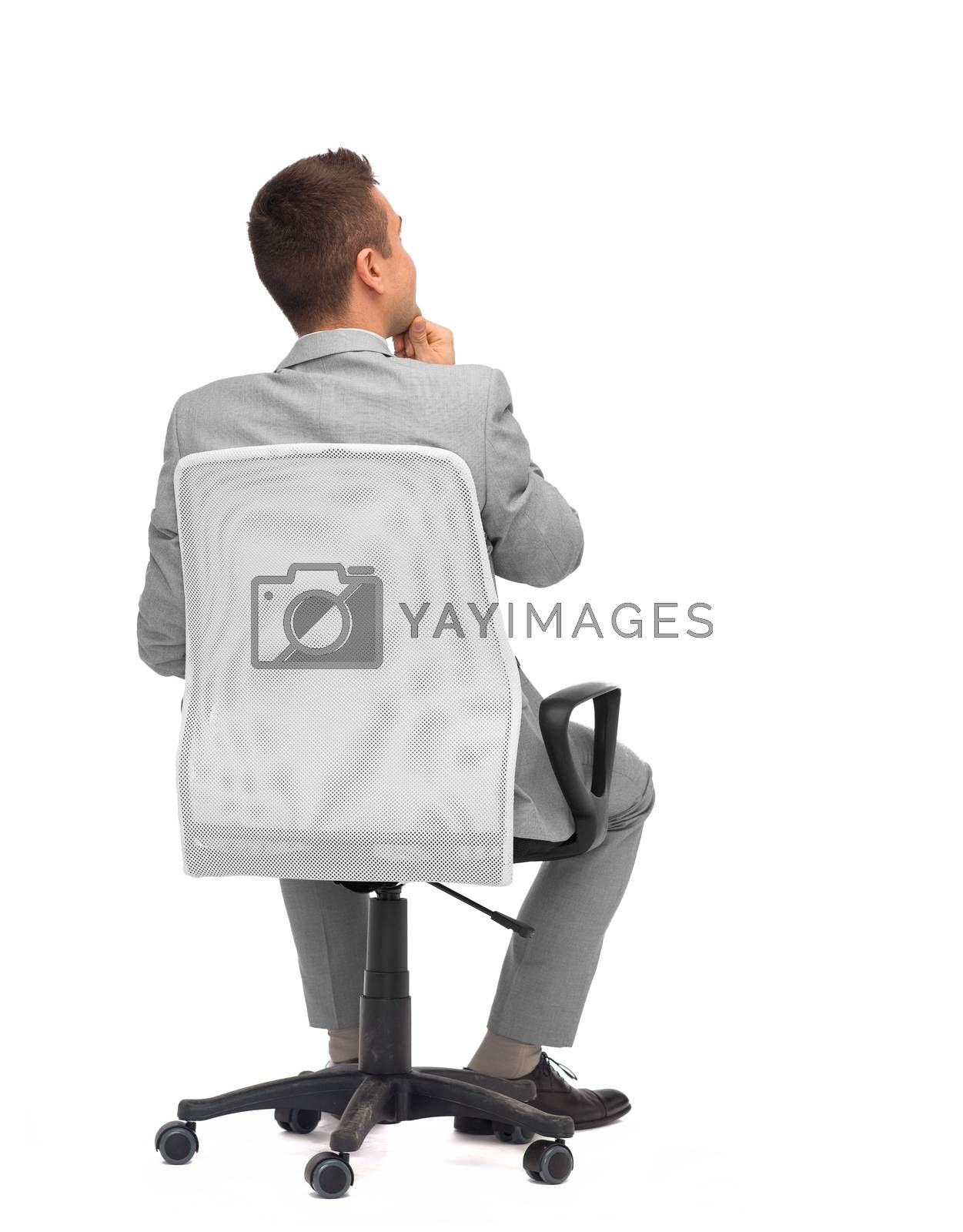 Royalty free image of businessman sitting in office chair from back by dolgachov