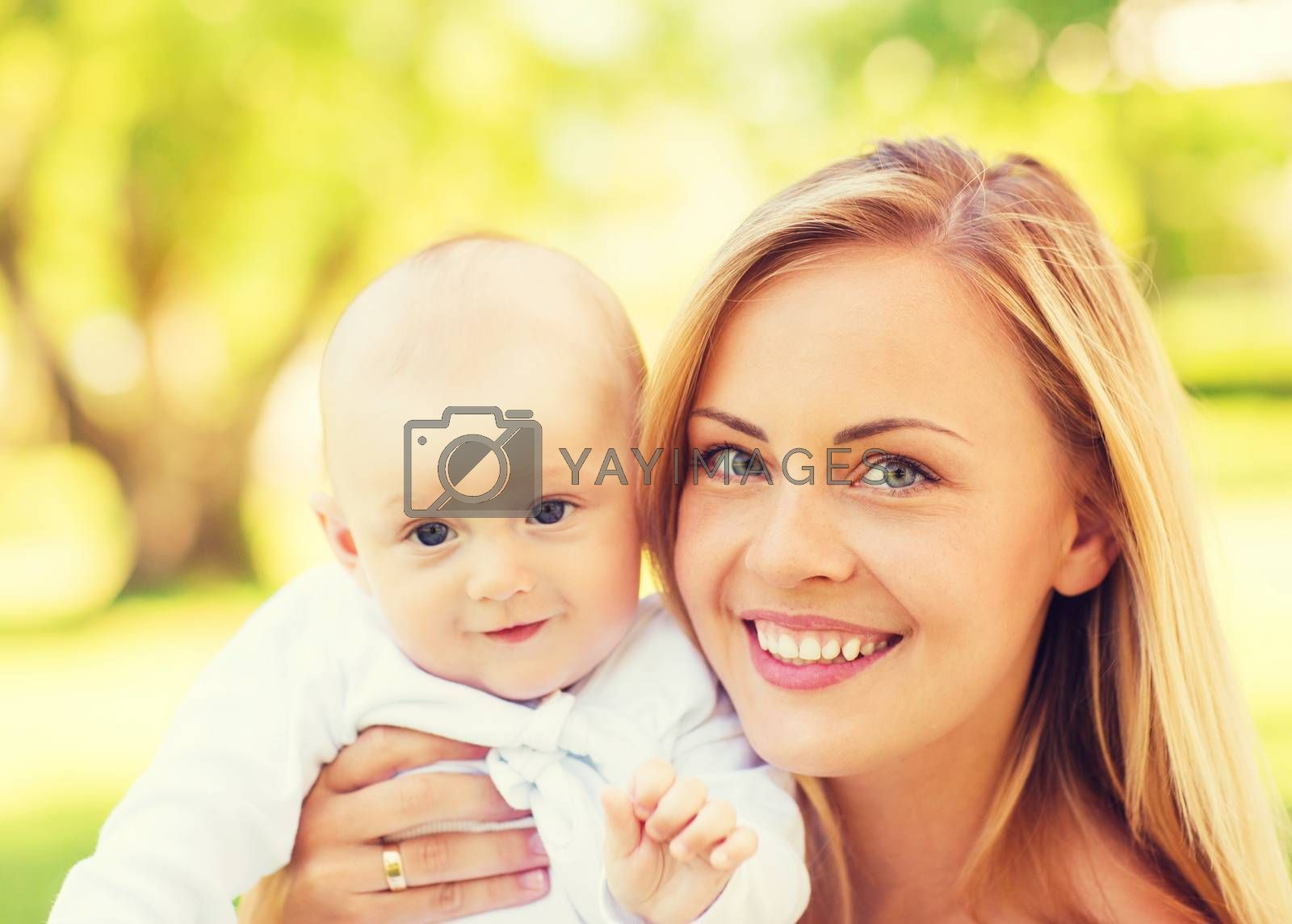family, child and parenthood concept - close up of happy mother with little baby in park