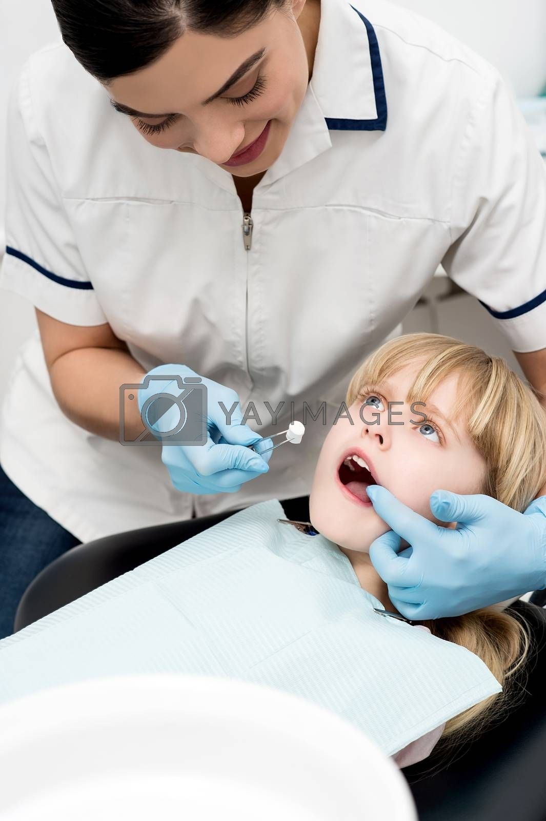 Little girl undergoing dental treatment at clinic
