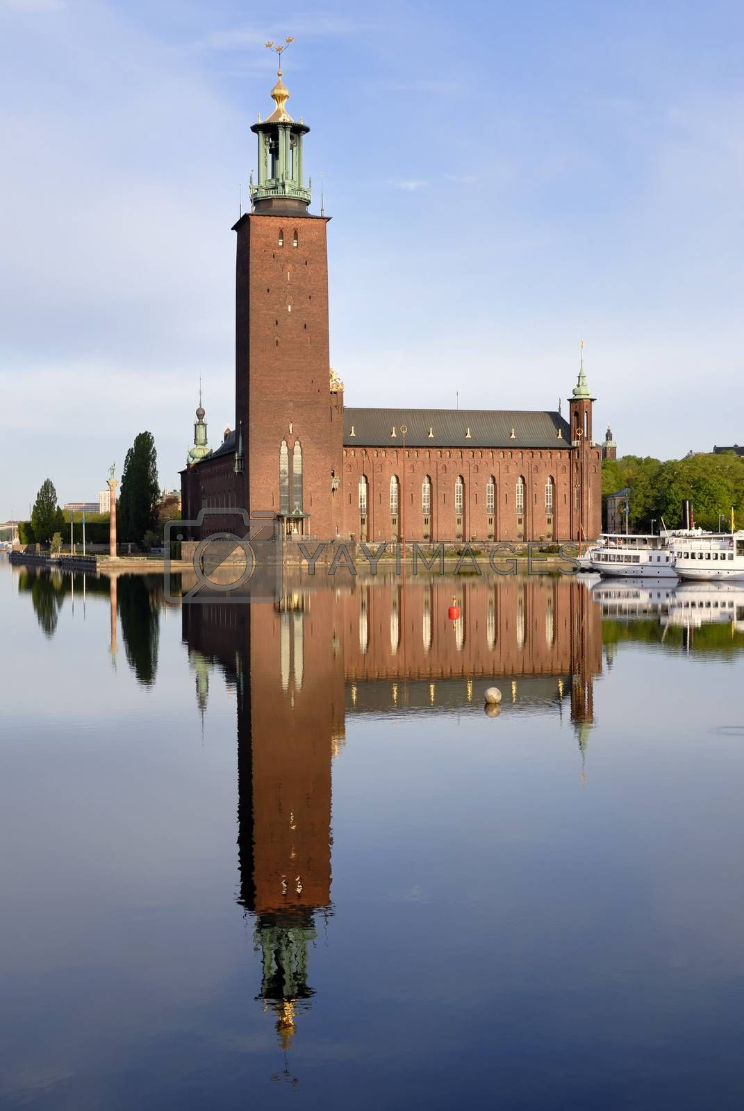 Stockholm City Hall with reflection on water.