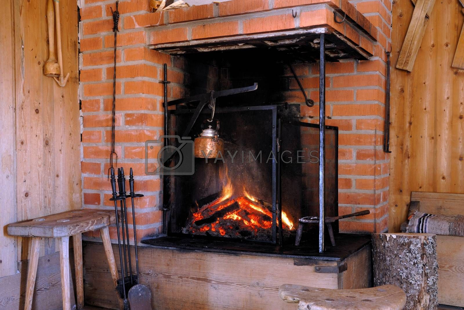 Wood fire in an old style wooden log cabin. A small house in Dalarna, Sweden.