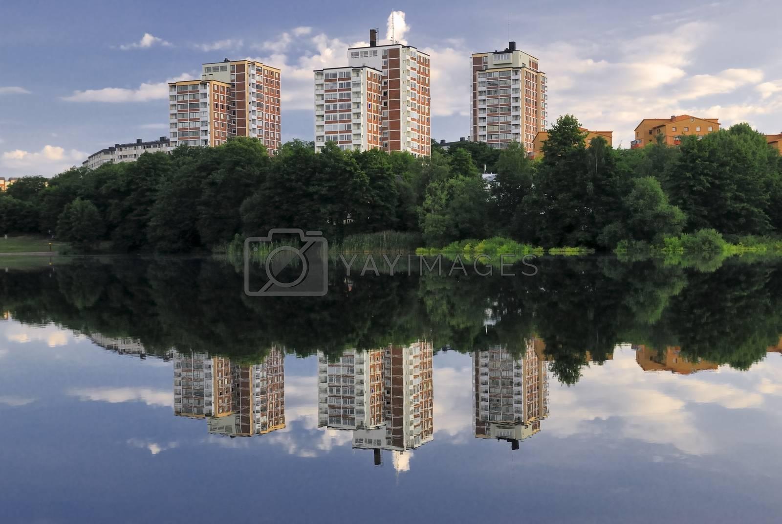 "Residential builduings near a lake ""Trekanten"" in Stockholm - Sweden.        Residential builduings near a lake"