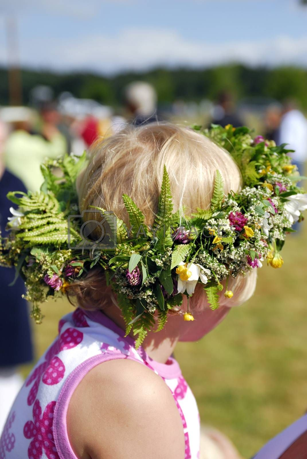 Midsommer (midsommar) flowers in young girls hair. Celebrating Swedish midsommar holiday.