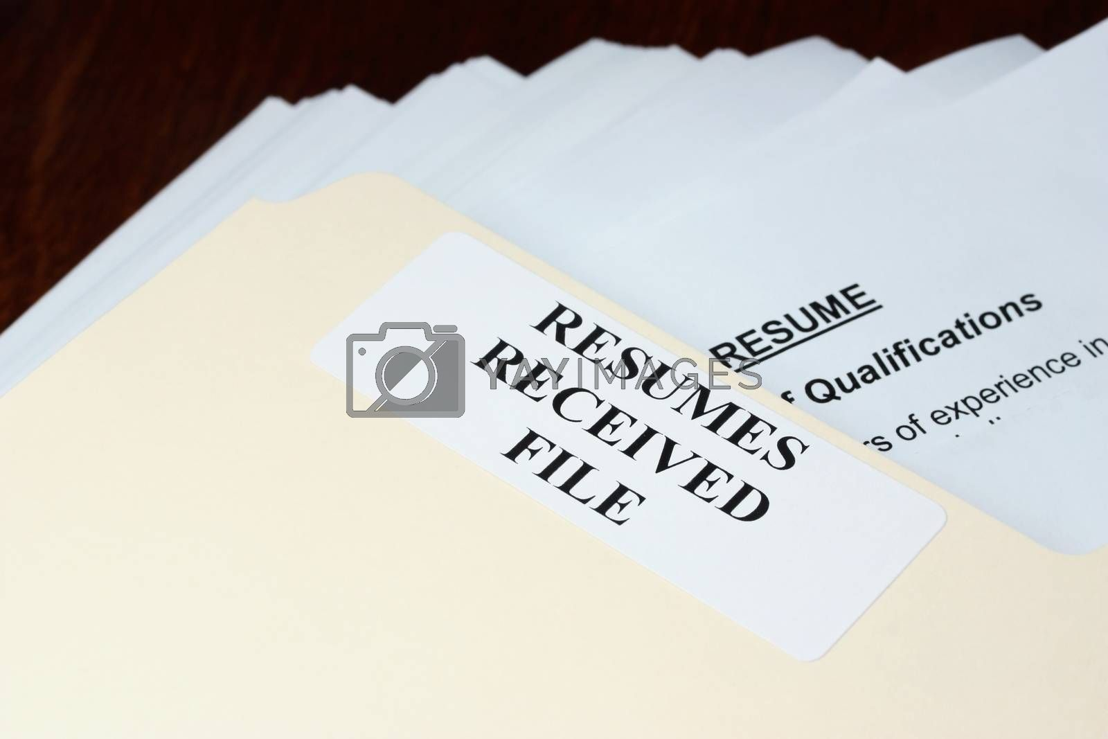 File with stack of resumes received