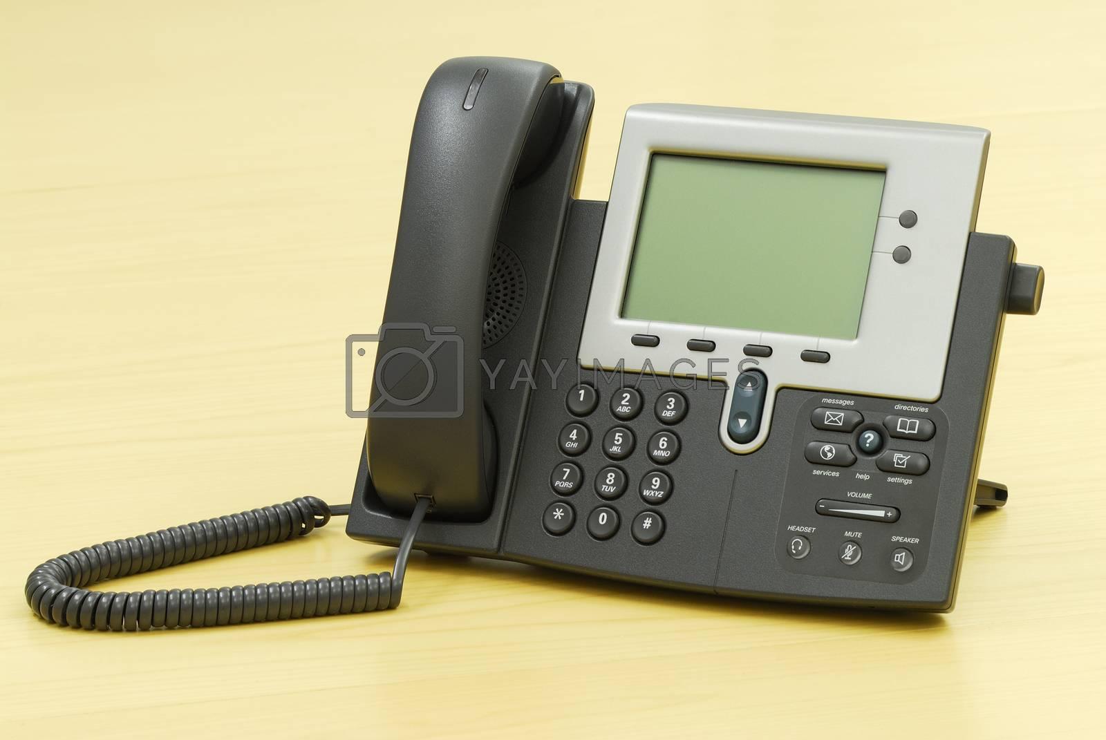 Digital VoIP phone on table.