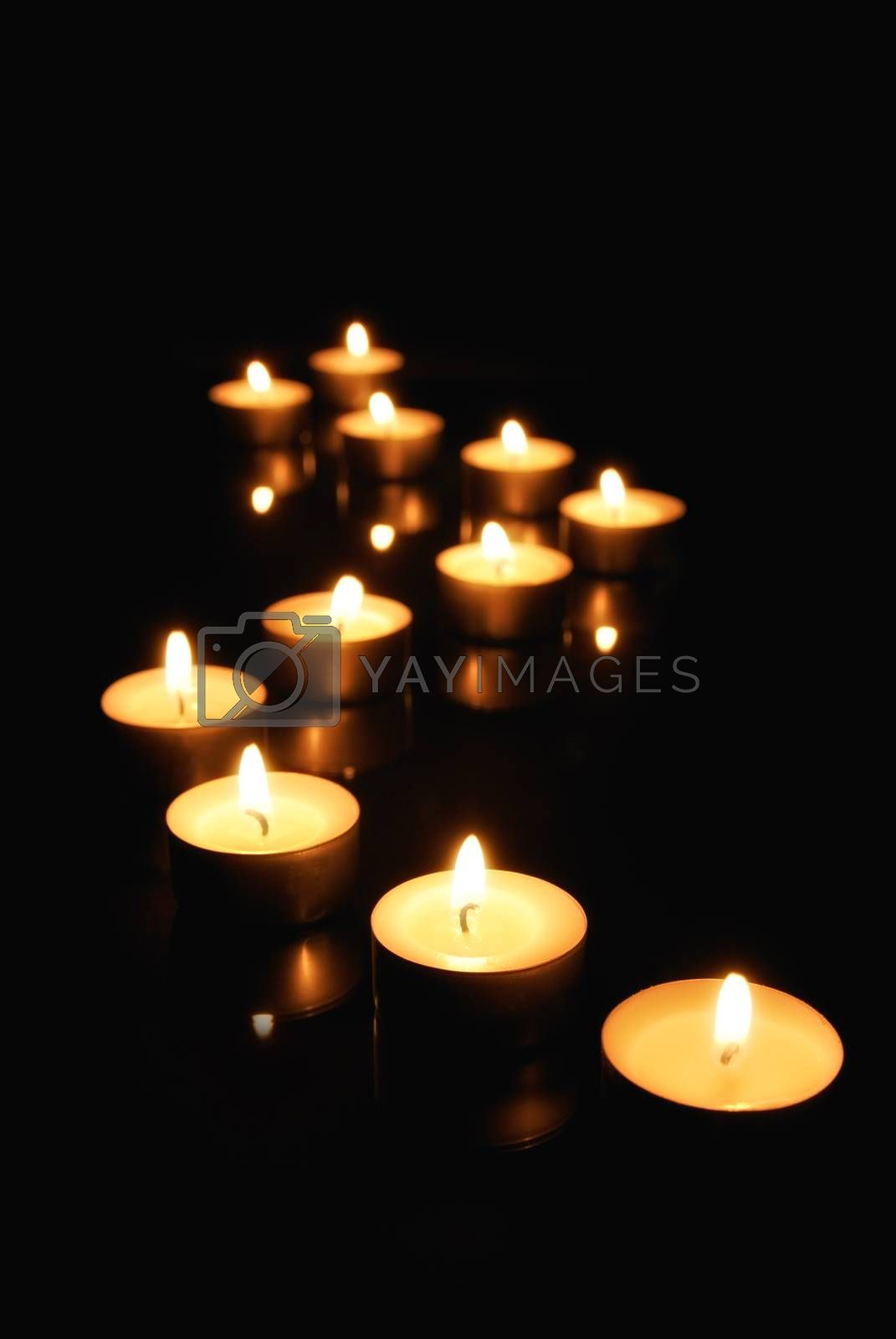 Small candles over black