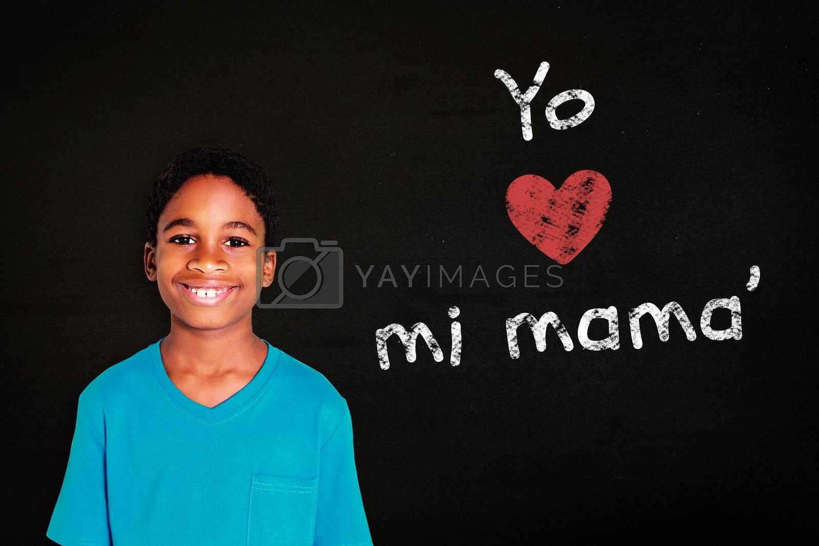 Cute boy smiling at camera against black