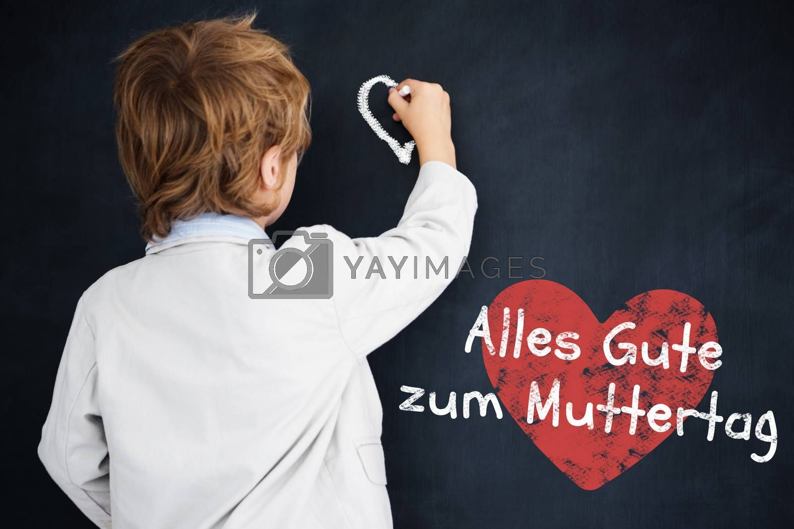 Cute pupil writing on board against black