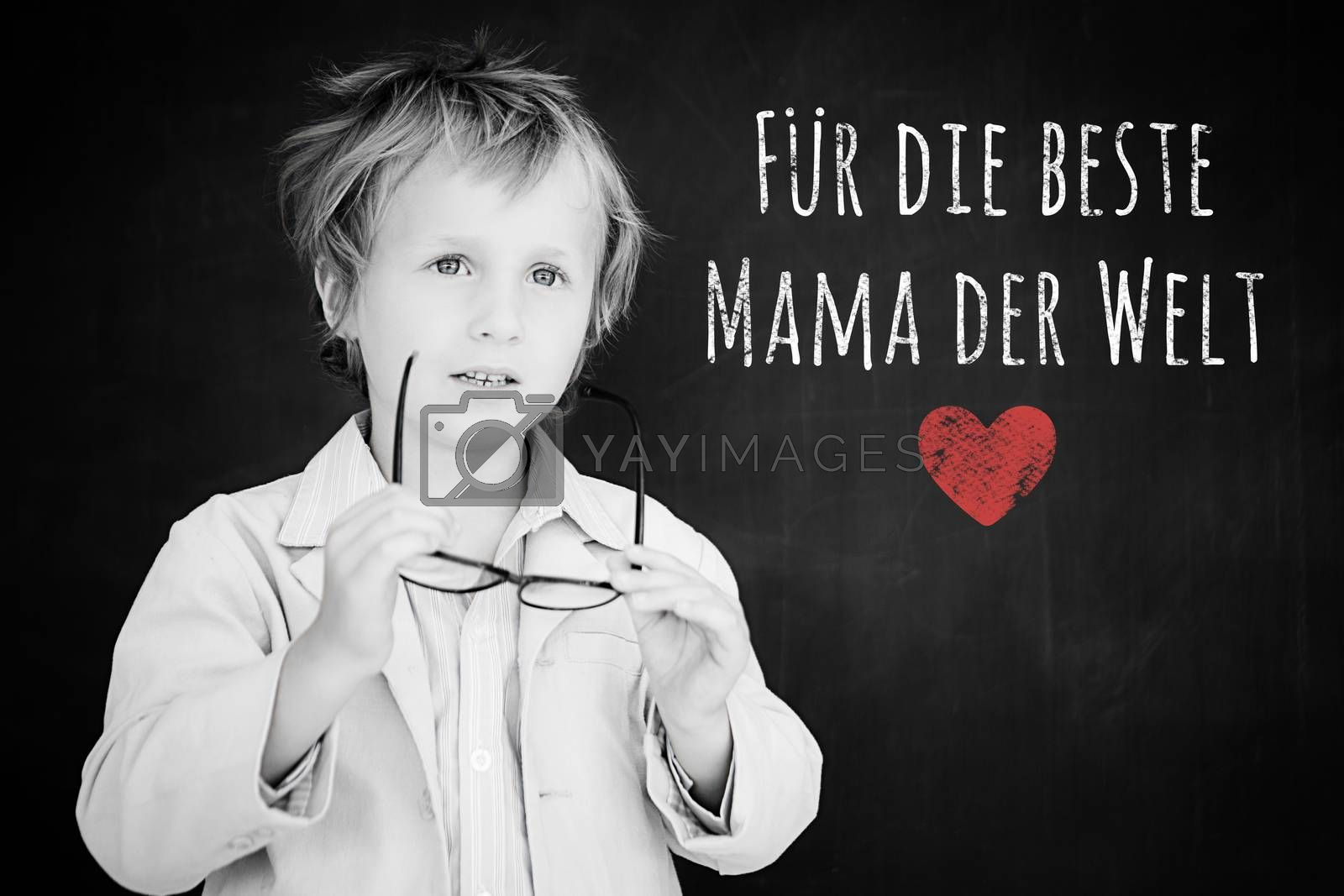 Schoolchild with blackboard against german mothers day message