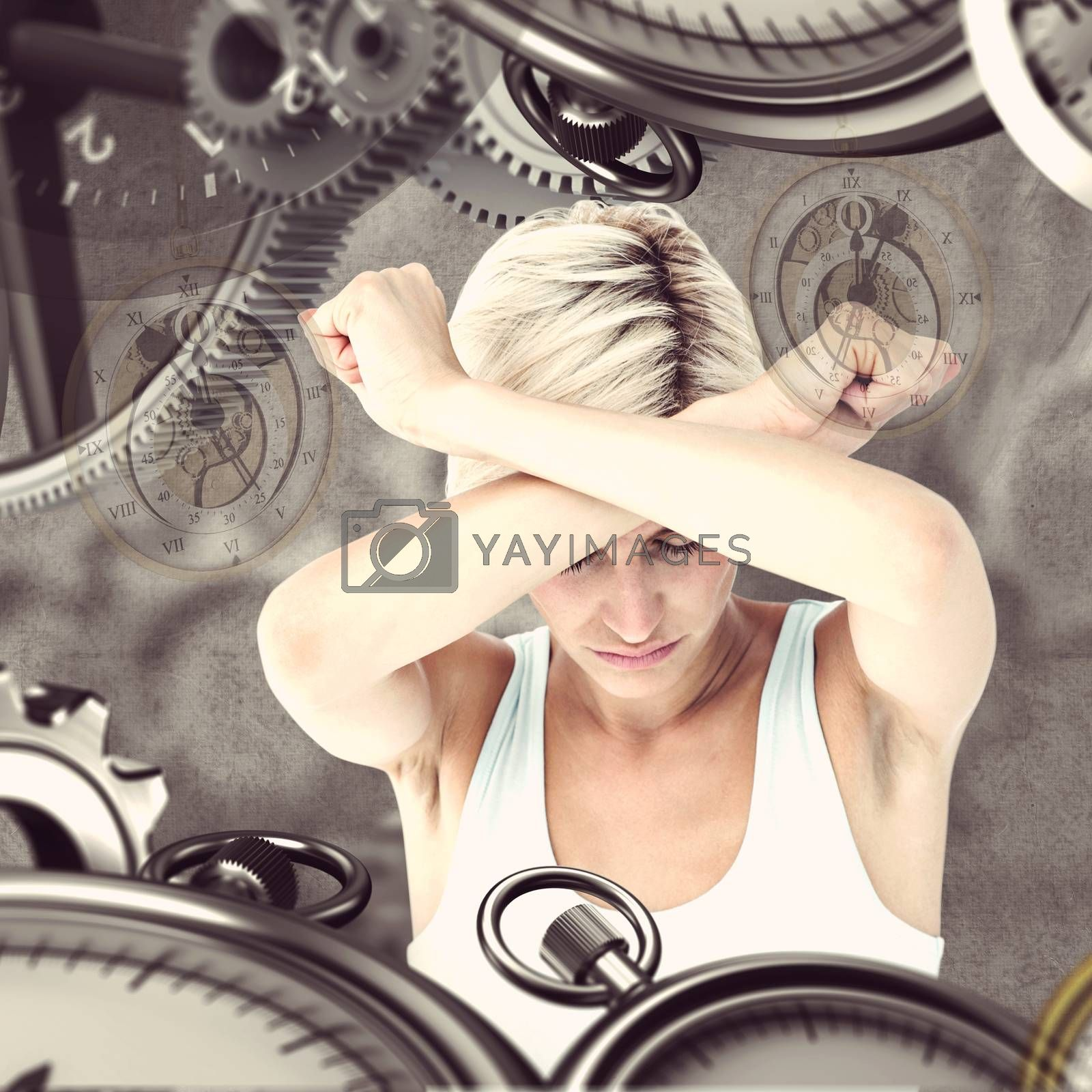 Upset woman holding her arms in front of her head against grey background