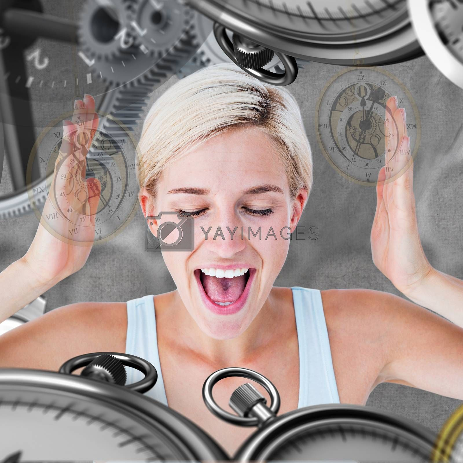 Happy blonde woman screaming with hands up against grey background
