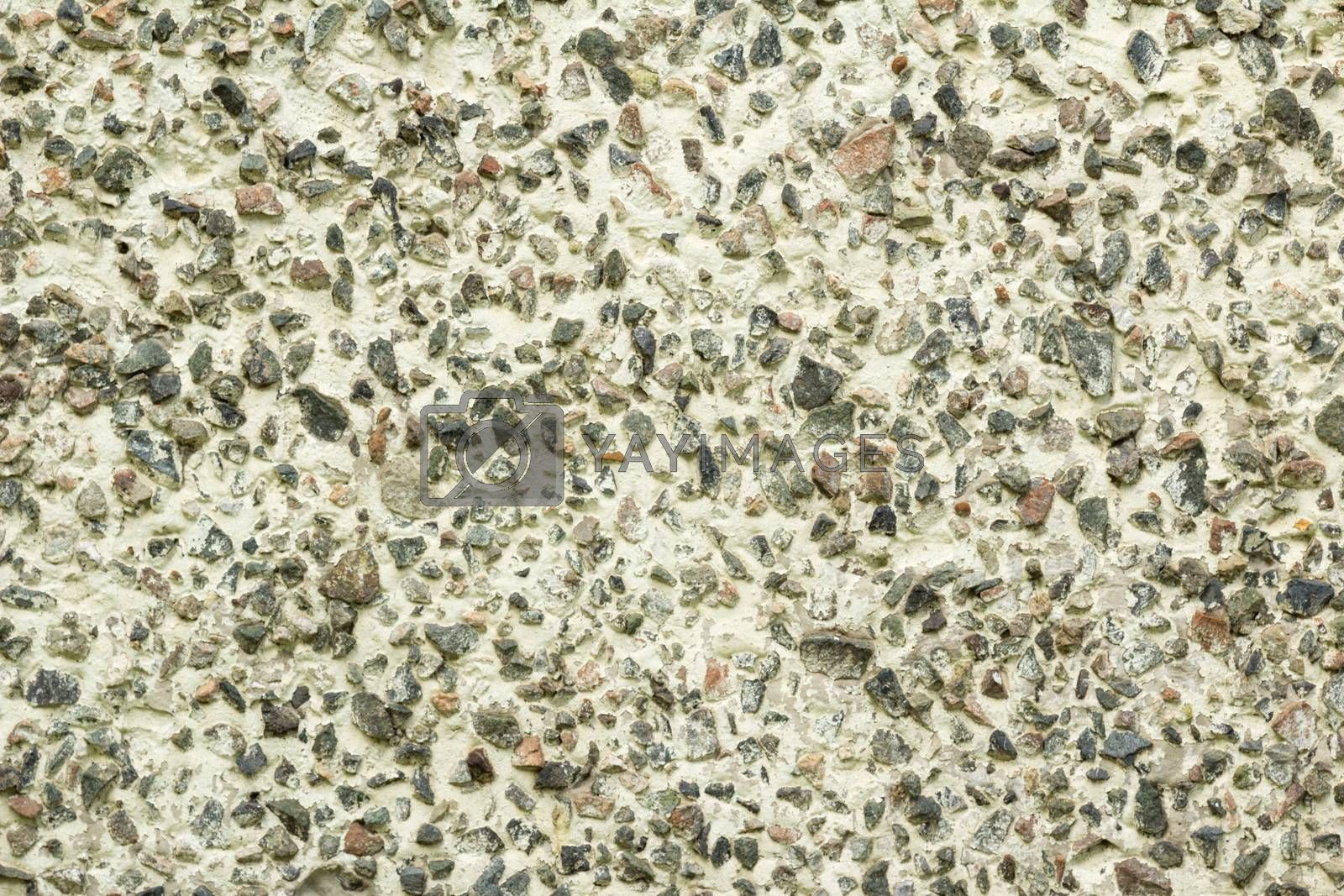 Background in the form of crushed stone on the white wall