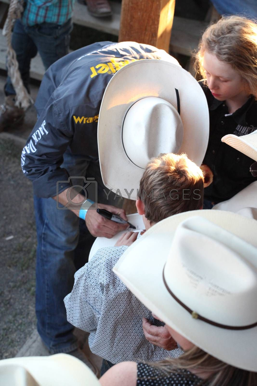 MERRITT; B.C. CANADA - May 30; 2015: Fans receiving autographs at The 3rd Annual Ty Pozzobon Invitational PBR Event.