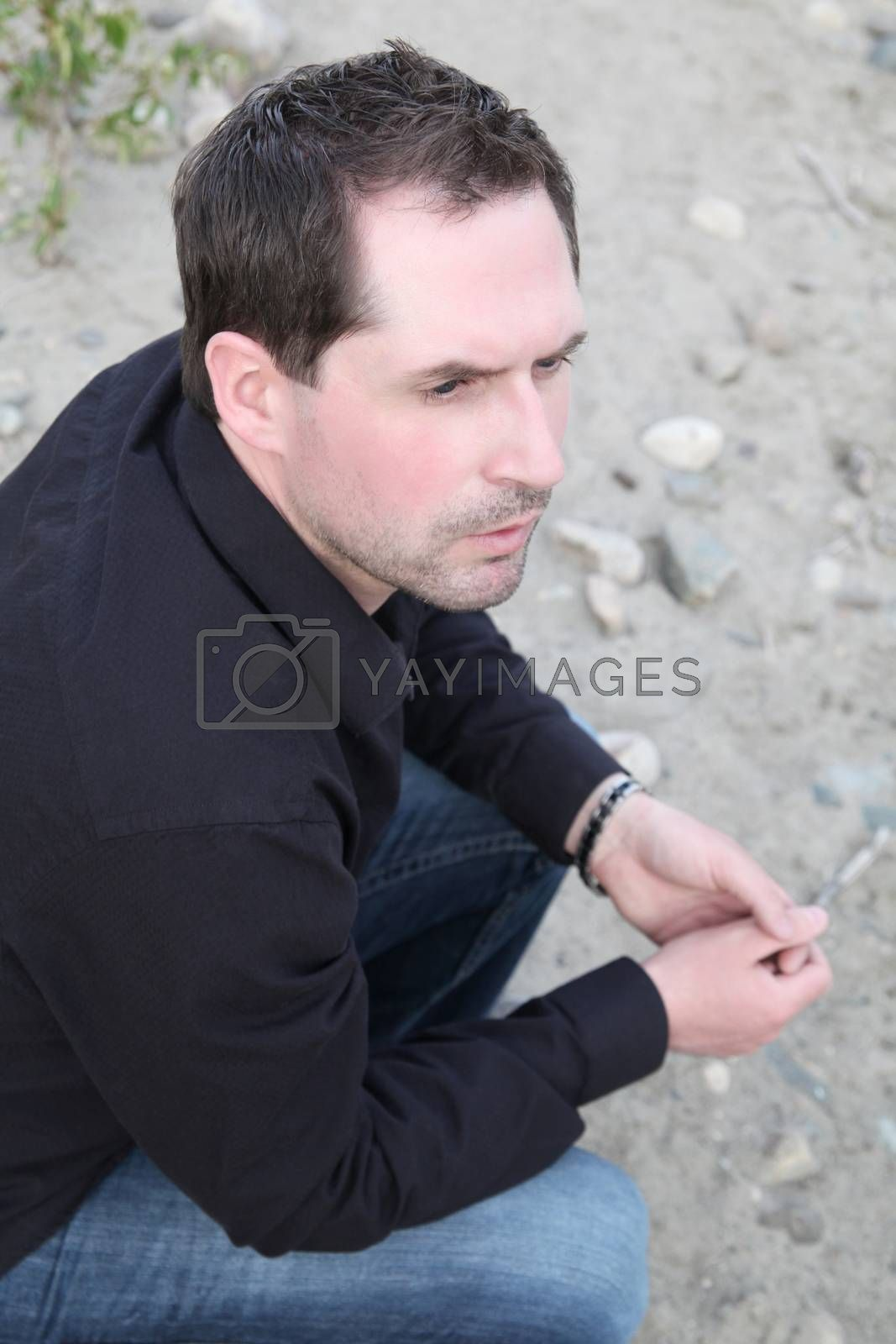 Attractive male model outdoors at the beach