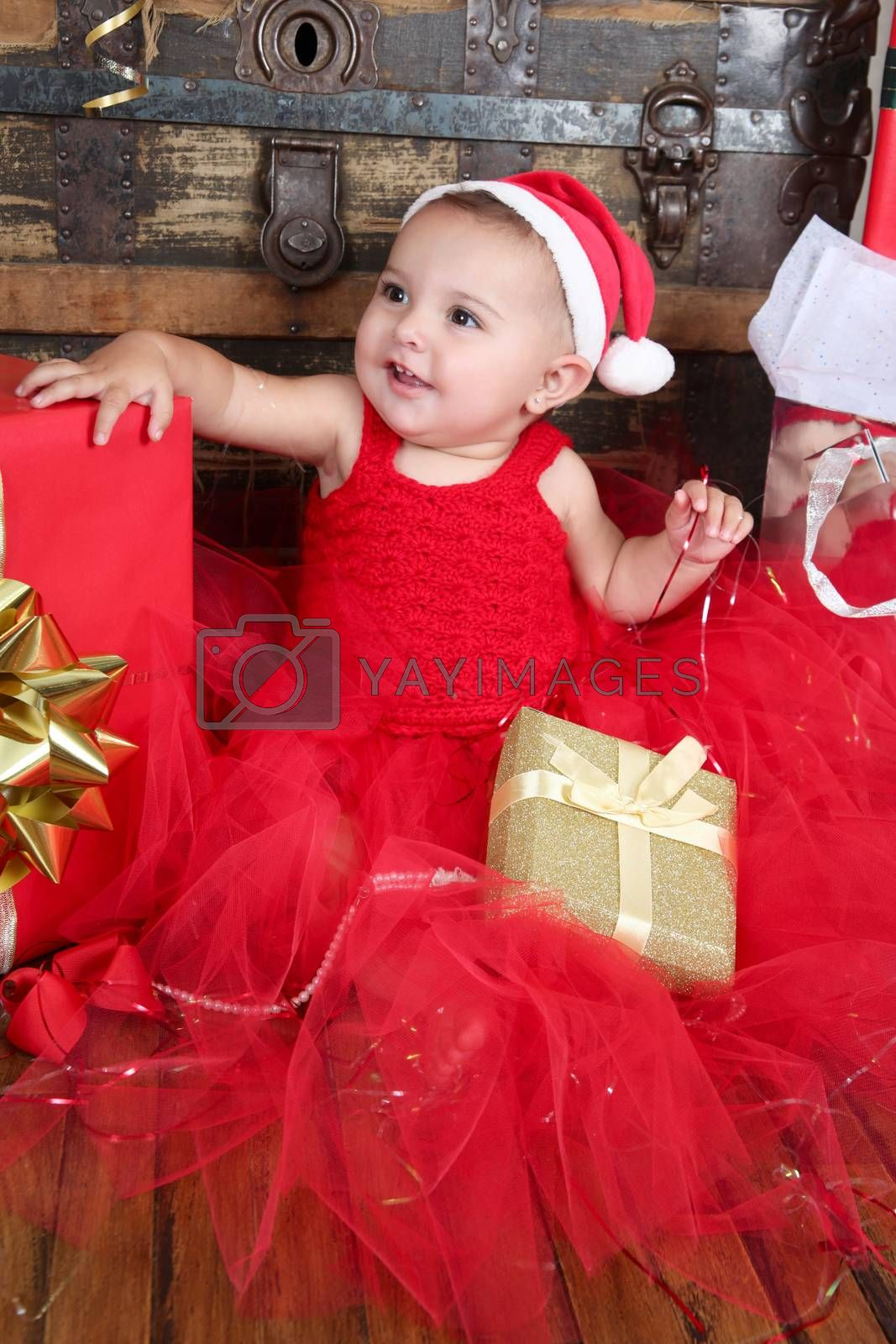Brunette christmas baby wearing a red dress