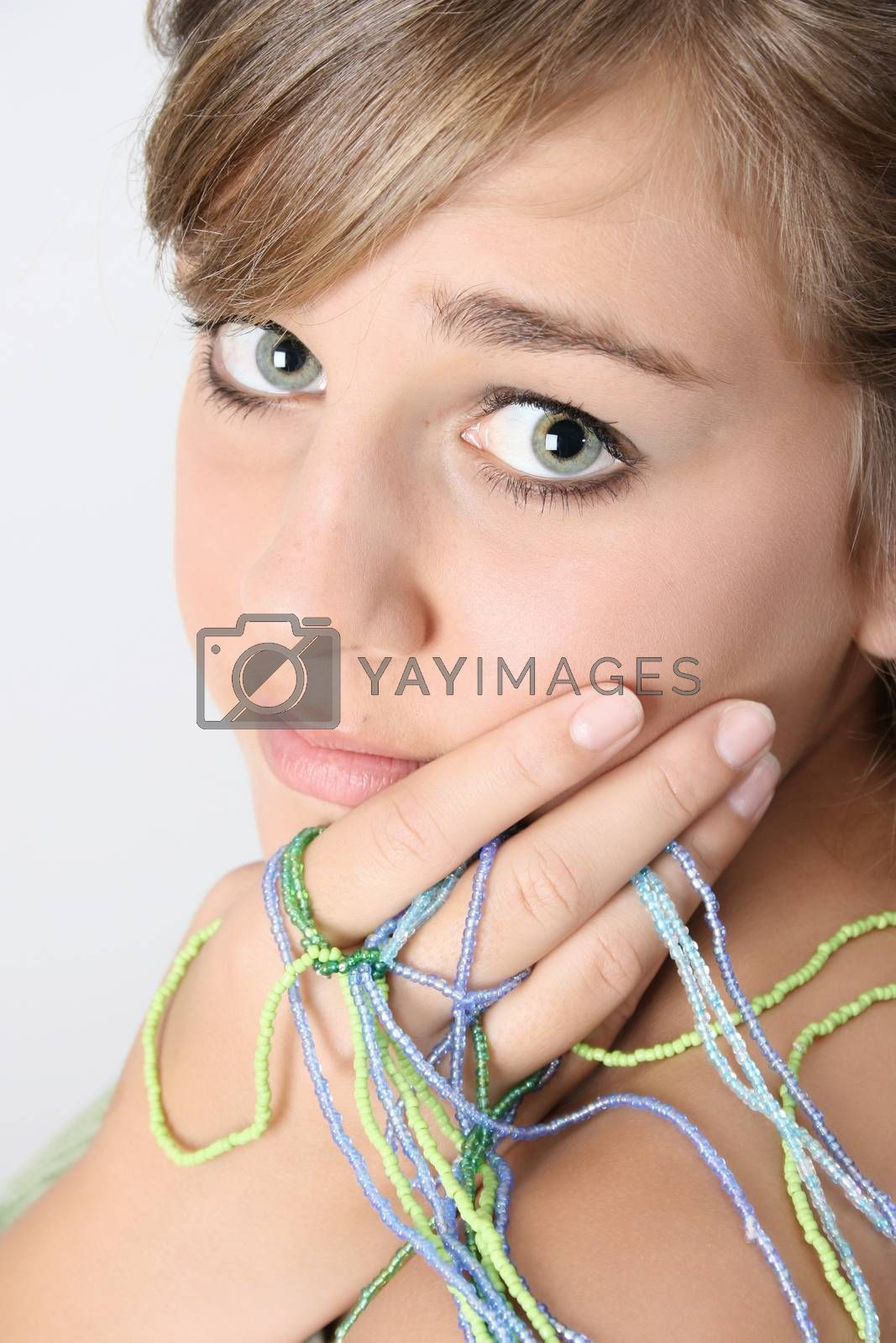 Innocent looking teenager with small beaded strings