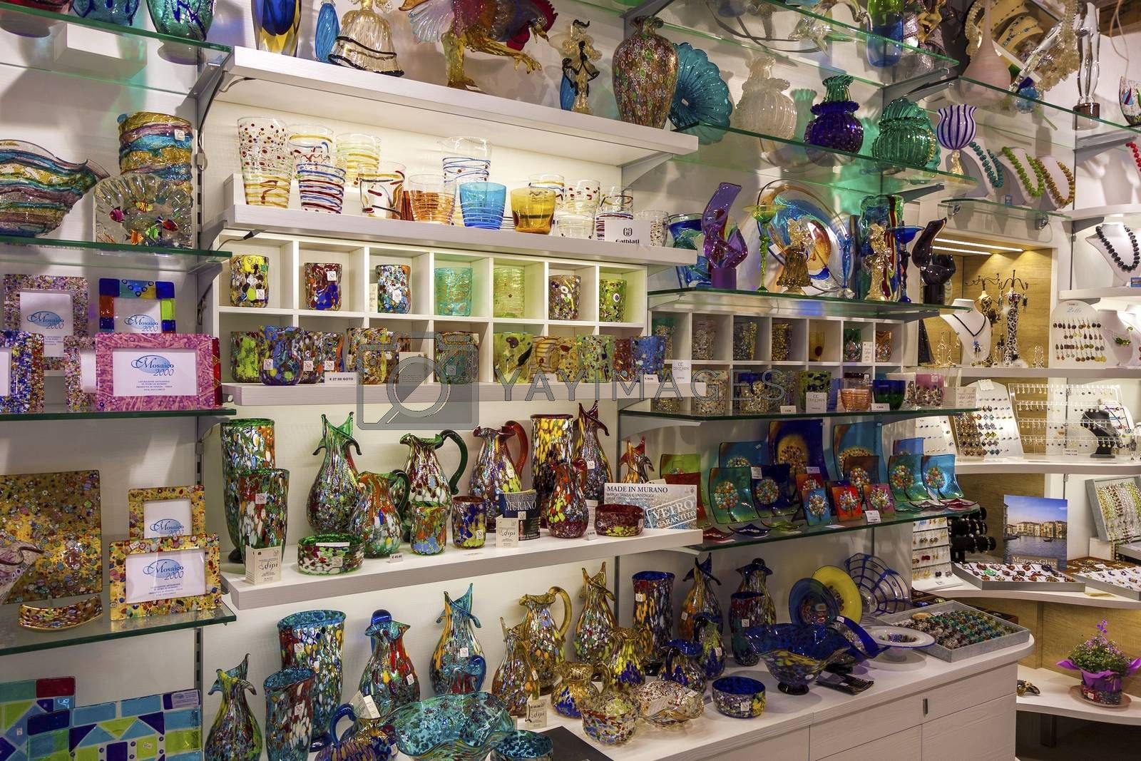 Venice, Italy - May 29, 2015: Murano glass artworks on display in shop in island of Murano, Venice.