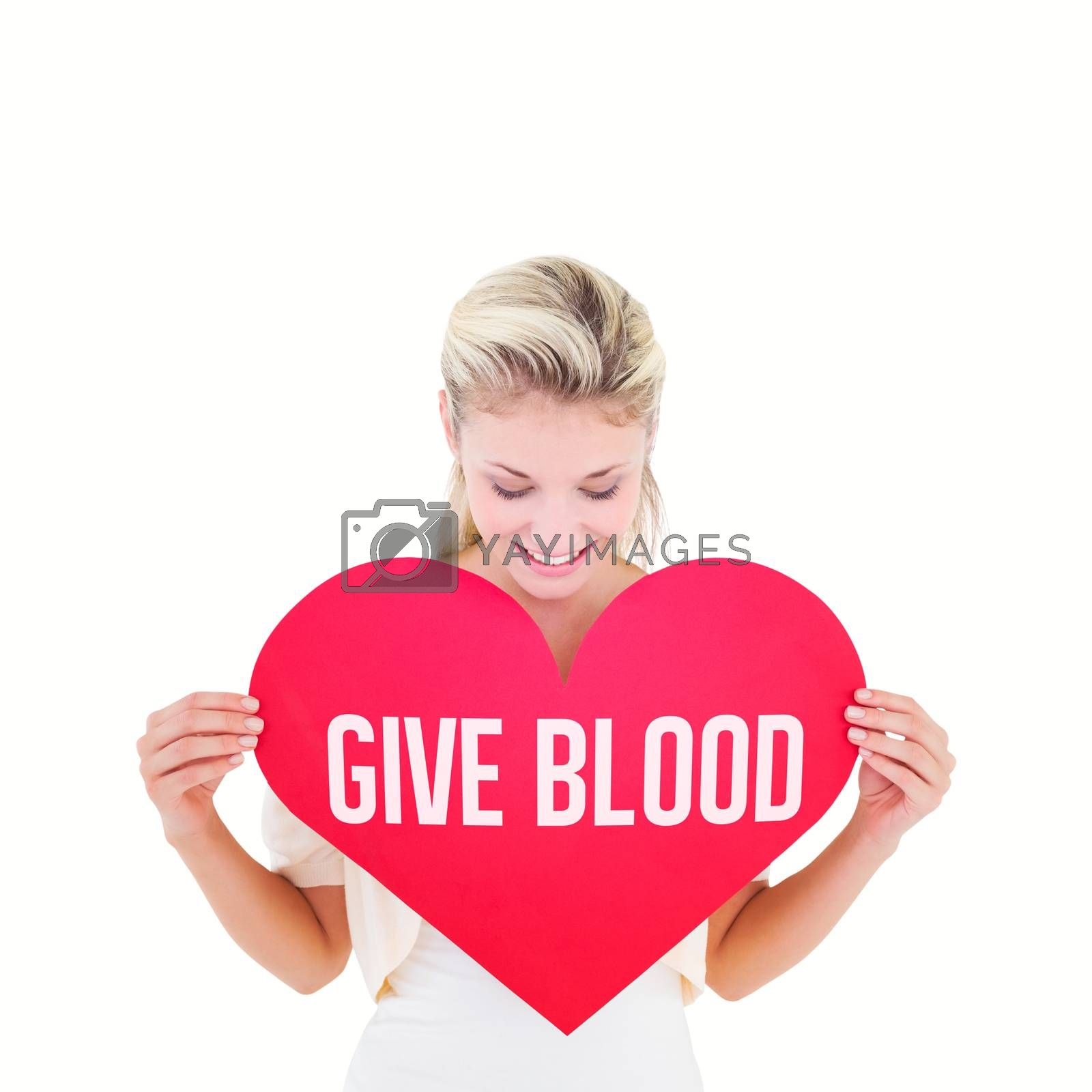 Attractive young blonde showing red heart against give blood