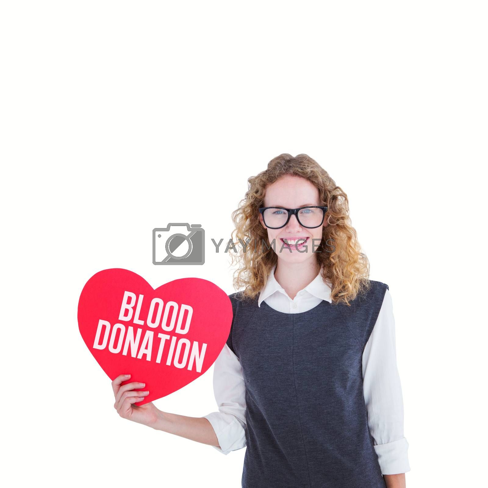 Geeky hipster holding heart card against blood donation