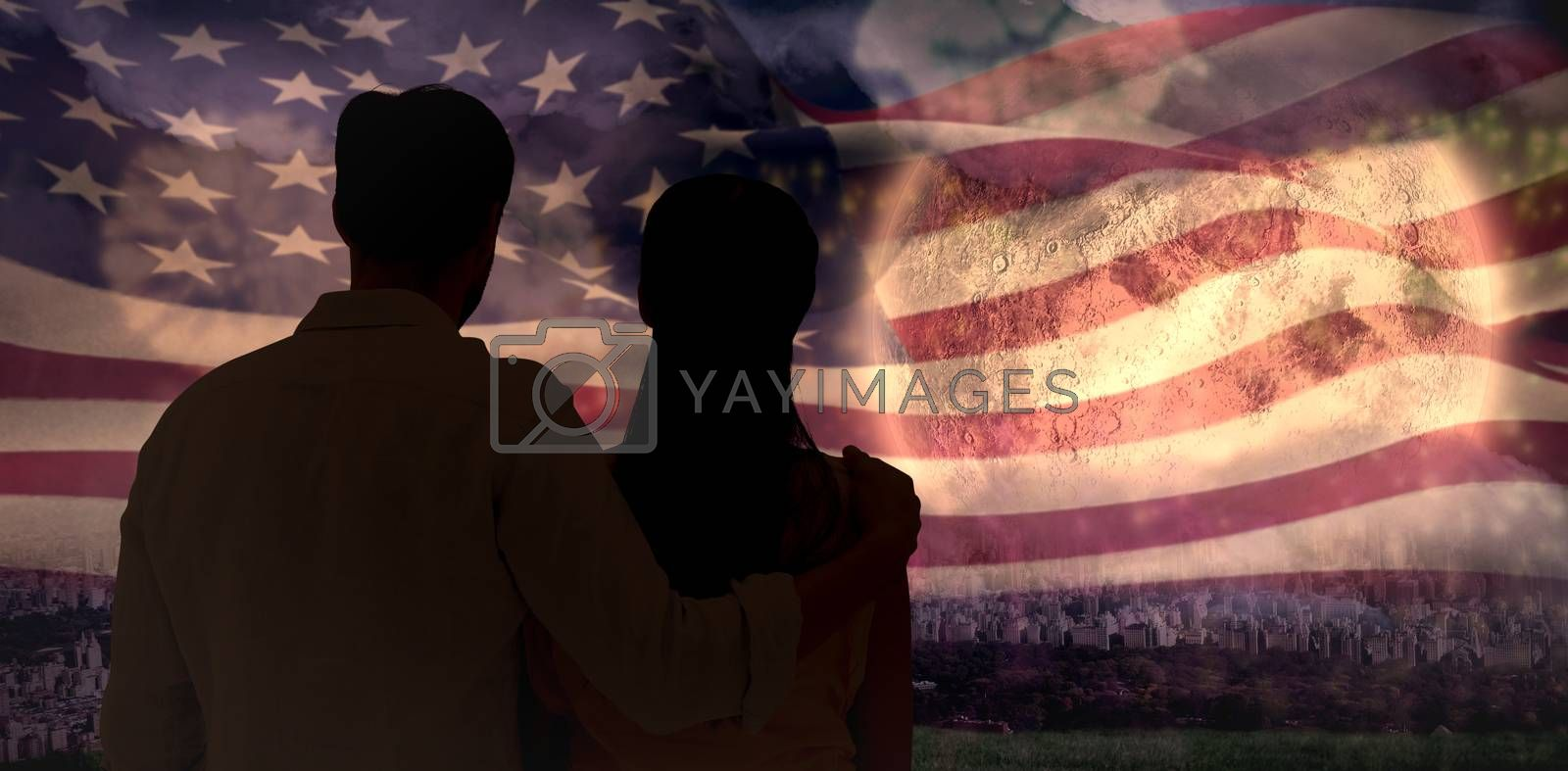 Attractive young couple standing and looking against colourful fireworks exploding on black background
