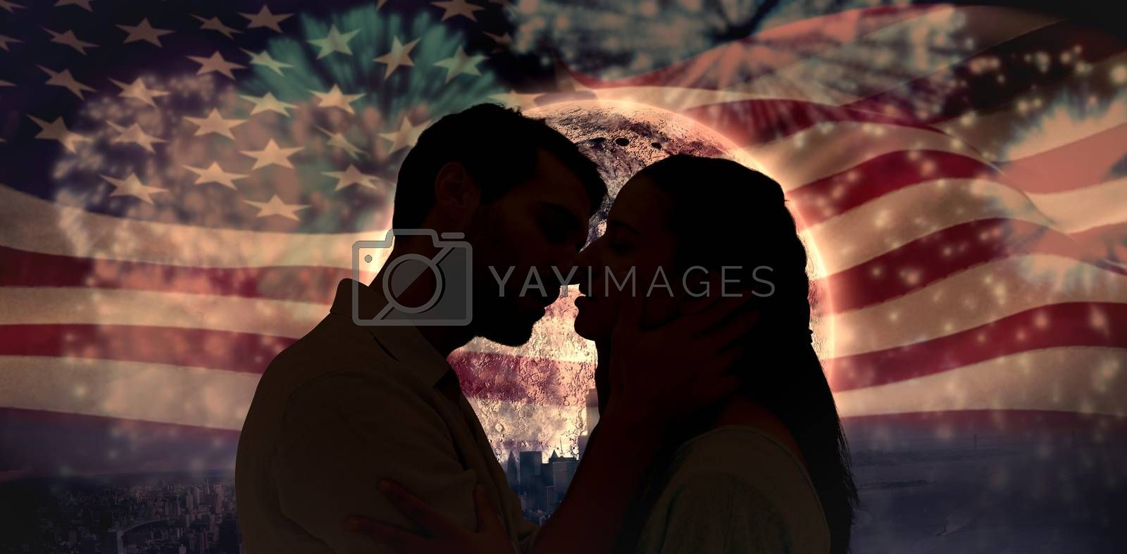 Attractive young couple about to kiss against colourful fireworks exploding on black background
