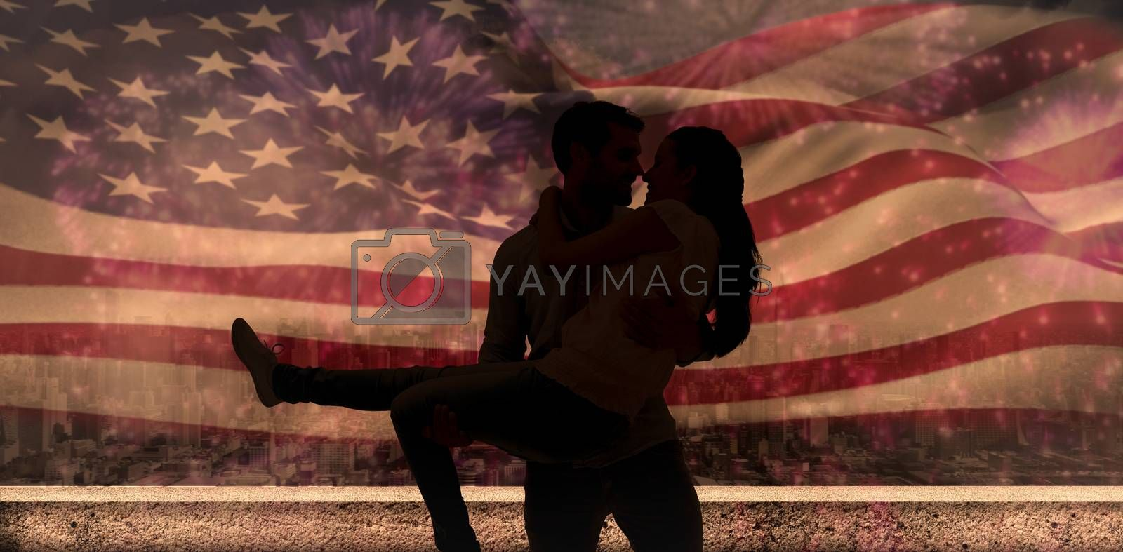 Attractive young couple having fun against colourful fireworks exploding on black background