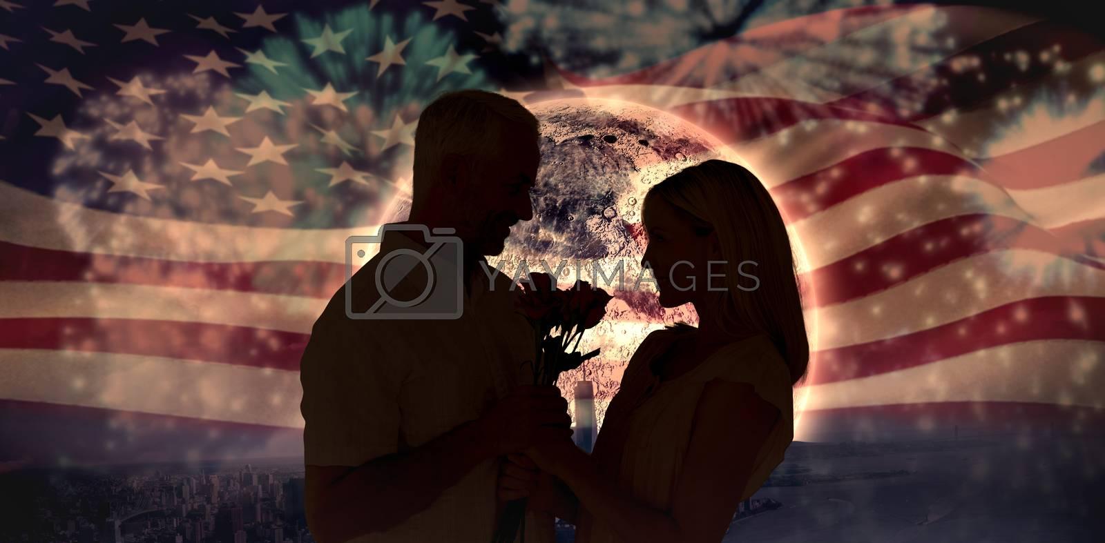 Affectionate man offering his partner roses against colourful fireworks exploding on black background