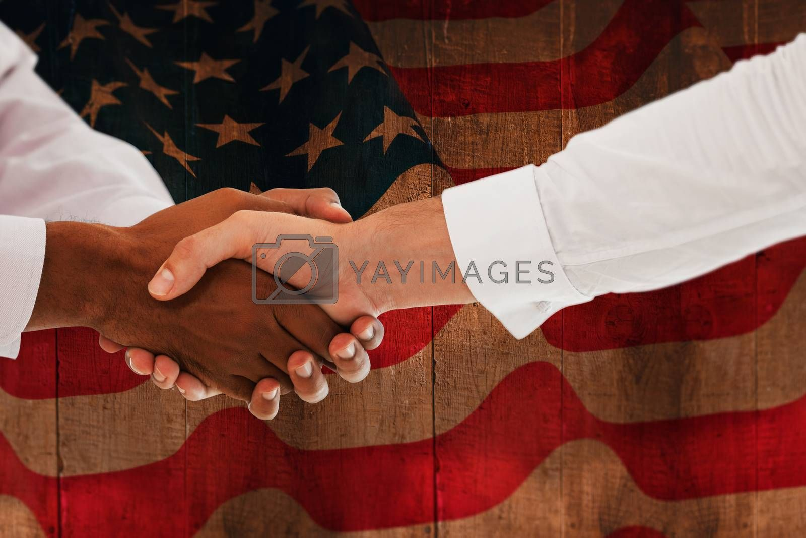 Composite image of close-up shot of a handshake in office by Wavebreakmedia