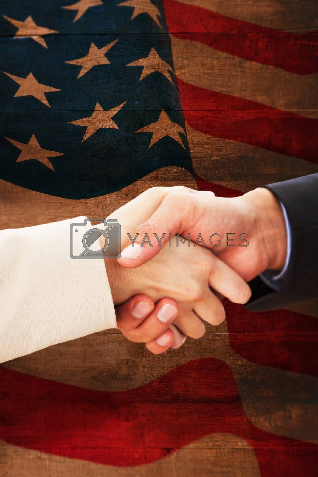 Composite image of close up on partners shaking hands by Wavebreakmedia