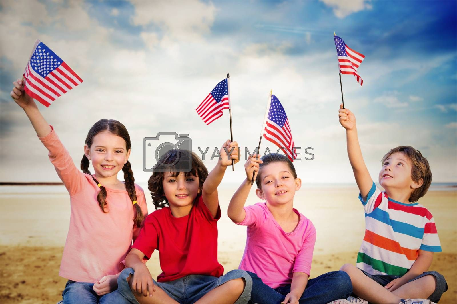 Children with american flags against serene beach landscape
