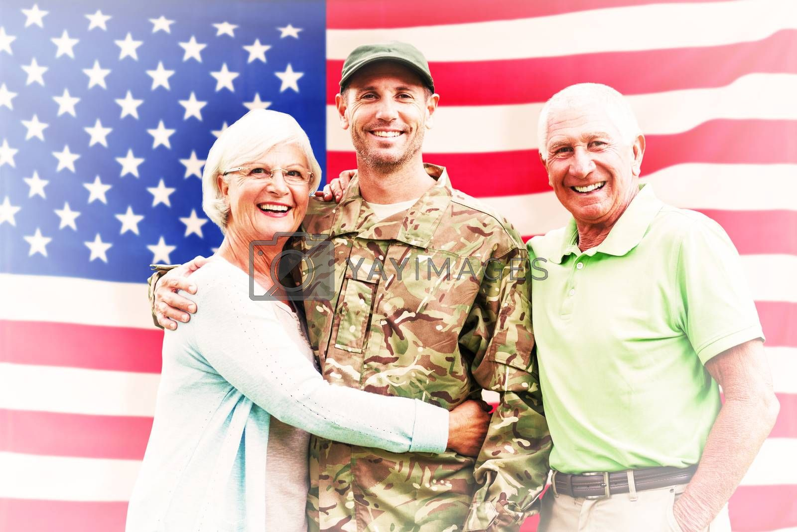 Soldier reunited with parents against rippled us flag