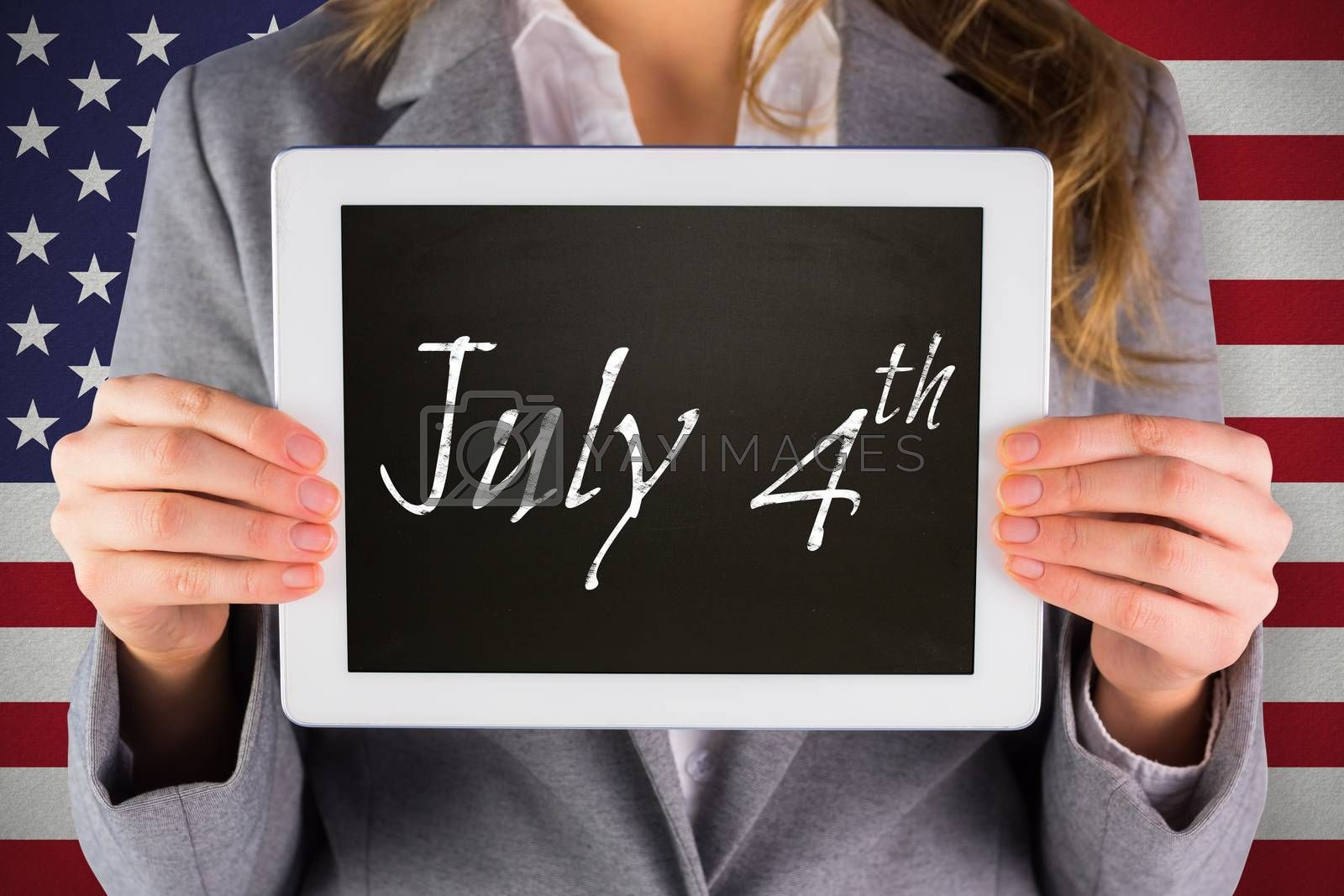 Businesswoman showing tablet against july 4th