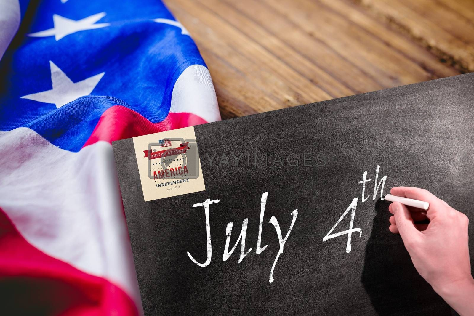 Independence day graphic against man drawing on chalkboard