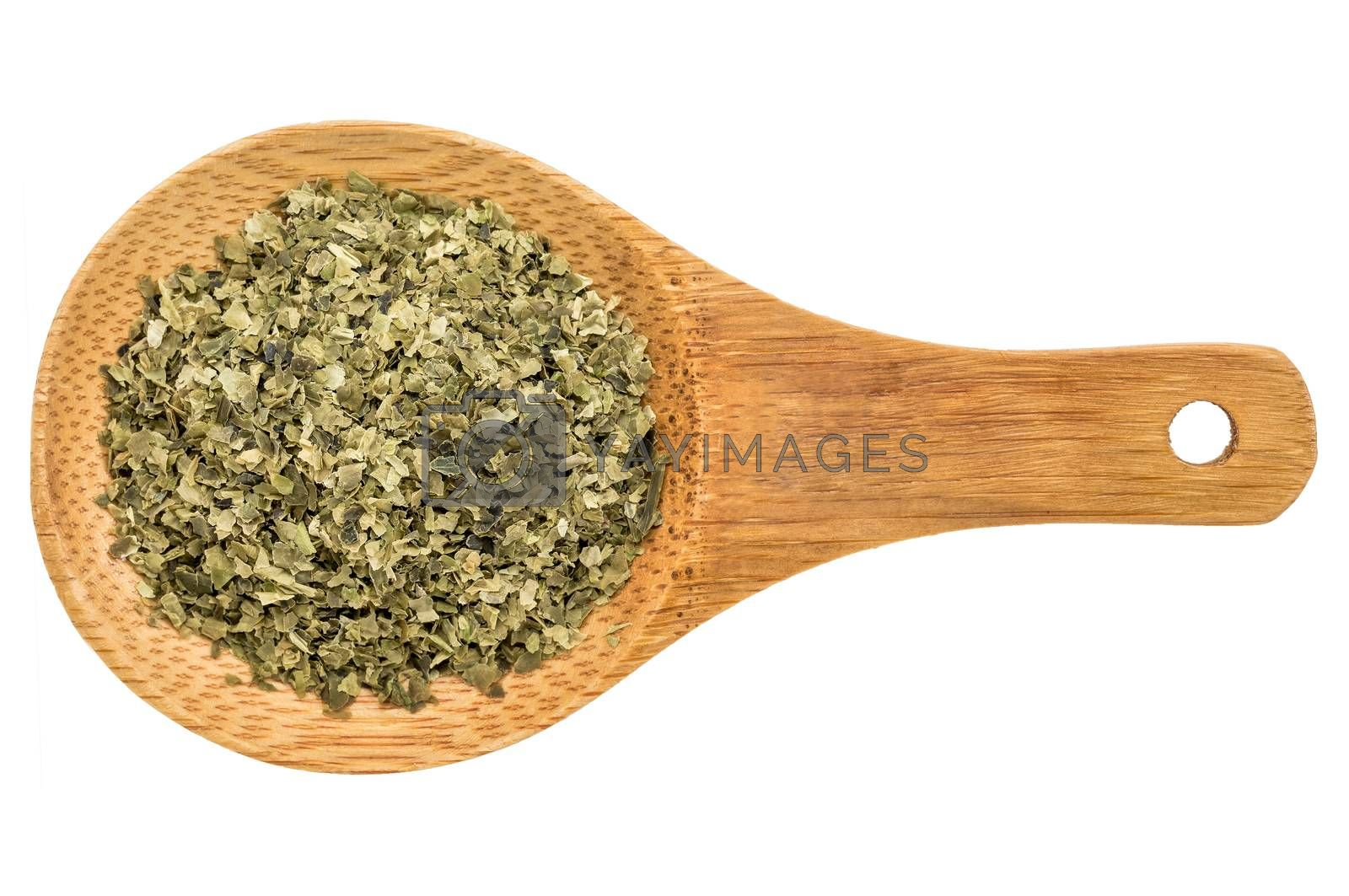 sea lettuce seaweed flakes - top view of a wooden spoon isolated on white
