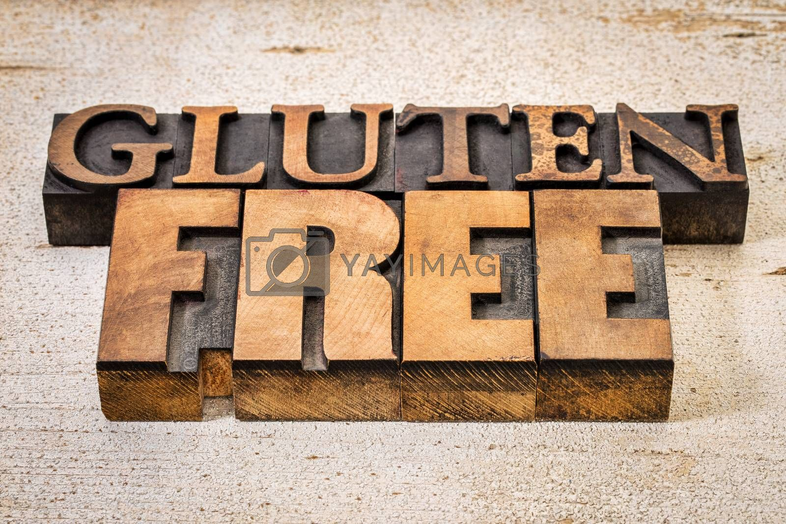 gluten free text in vintage letterpress wood type against white painted rustic barn wood