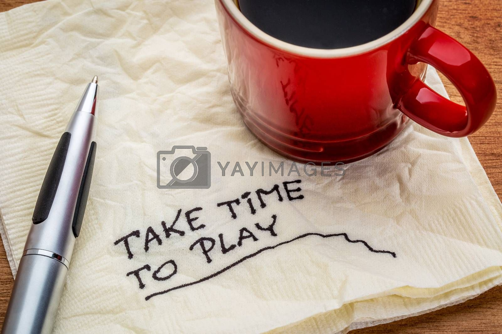 Take time to play advice on a napkin with a cup of coffee - work life balance concept