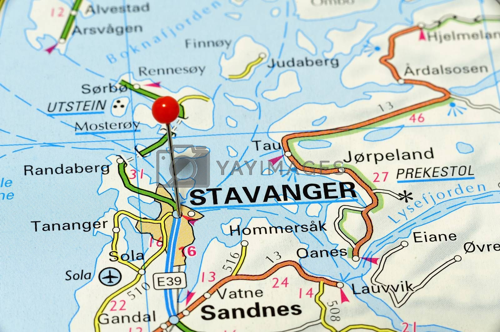 Stavanger - famous city in Norway. Red flag pin on an old map showing travel destination.