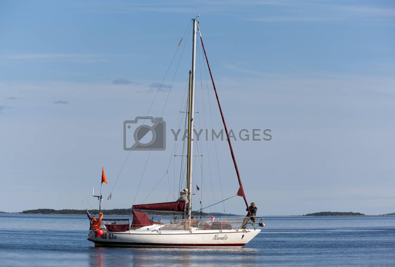 "Russia, Kandalaksha - JUNE 30, 2015: The regatta of cruiser yachts in the White Sea. Judging boat yacht ""Navalis"" Arkhangelsk"