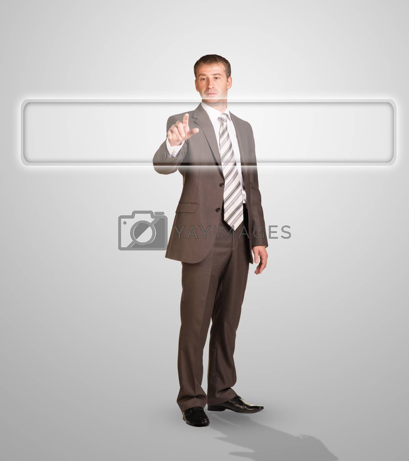 Businessman standing and pressing on holographic screen on abstract grey background, close-up view